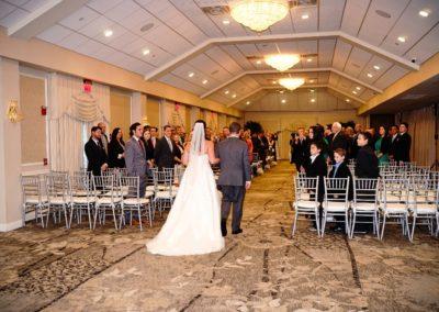 Bride-and-Groom-Walking-Down-Atrium