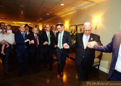 Jewish men, including groom dancing.