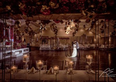 Bride and Groom on Grand Ballroom dance floor kissing.